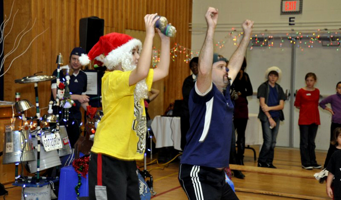 Jonny shows a volunteer how to move and shake like Santa.